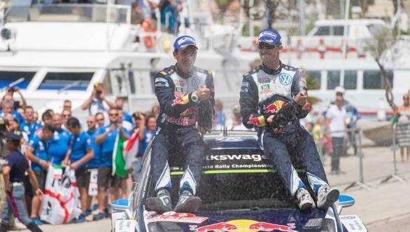 Julien Ingrassia and Ogier celebrate their win at the Rally of Sardinia - they seem to be getting used to this!