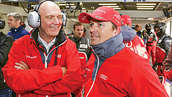 All smiles are Dr Wolfgang Ullrich and Marcel Fassler here, even though it was a tense time for the defending champions Audi at Le Mans