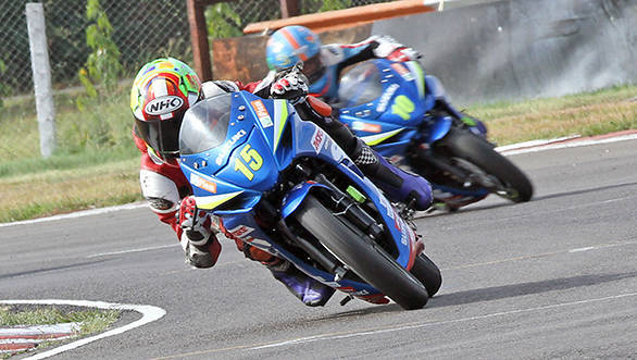 Ananthraj (No.15) in the lead at the last corner while winning the Suzuki Gixxer Cup (Open) race in Chennai on Saturday.