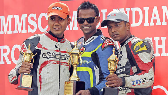 Rajini Krishnan (centre) of Moto-Rev Yamaha Racing team, who won the Group B (165cc) Open race on Sunday in the MMSC FMSCI Indian National Racing Championship, flanked by second-placed Harry Sylvester of TVS Racing (right) and third placed Sarath Kumar of Ten10 Racing (left).
