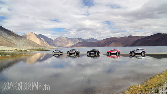 The Audi SUVs pose against the backdrop of the Pangong Lake