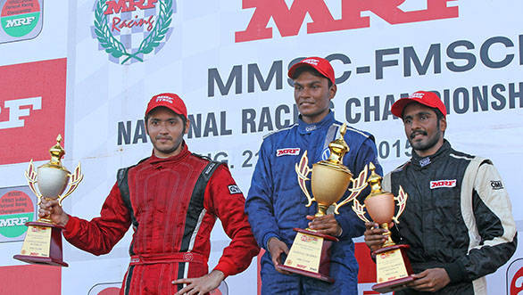 Karthik Tharanisingh (centre), winner of the MRF FF1600 championship title, flanked by second placed Goutham Parekh (left) and third placed Arjun Narendran