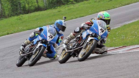 Jagan Kumar (No.3) slips past his TVS Racing team-mate Harry Sylvester on way to winning the Group B (165cc) Open race in the third round of the MMSC FMSCI Indian National Racing Championship in Chennai on Saturday