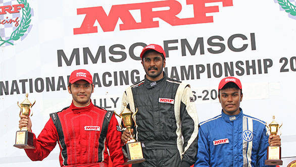 Arjun Narendran (centre), winner of the second race in the MRF F1600 class flanked by second-placed Goutham Parekh (left) and Karthik Tharanisingh who came in third