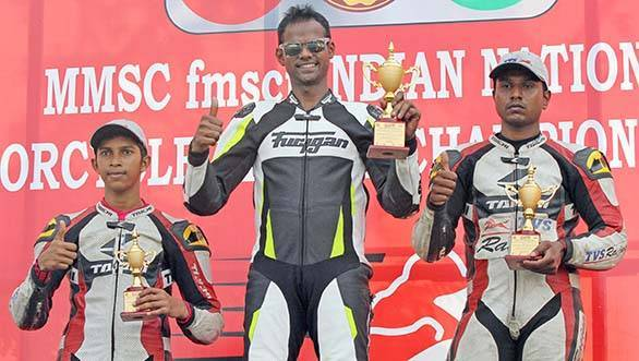 Rajini Krishnan of Moto-Rev Yamaha Racing (centre), winner of the Group B (165cc) Open race flanked by second placed Harry Sylvester (right) and KY Ahamed (both of TVS Racing) in the MMSC FMSCI Indian National Motorcycle Racing Championship in Chennai on Sunday.