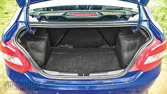 The boot has a tall and narrow opening with significant suspension intrusions