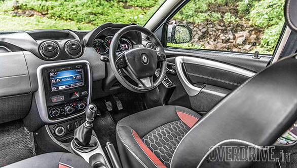 The updated Duster interior is better than before – fit and finish has improved too. The dials are new but chrome outline is loud. Centre touchscreen is offered as standard and features various functions including navigation