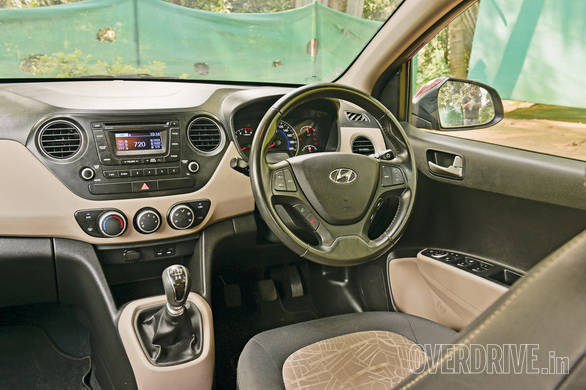 The Hyundai Grand i10's interiors are just a little bit better than the Figo with thoughtfully placed storage and just as much space