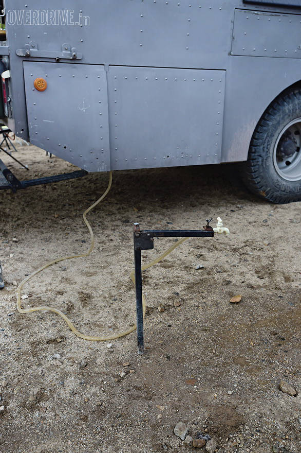 Captain has several innovations on board, from expensive water pumps to this simple metal contraption that turns a water pipe into an easy to use tap