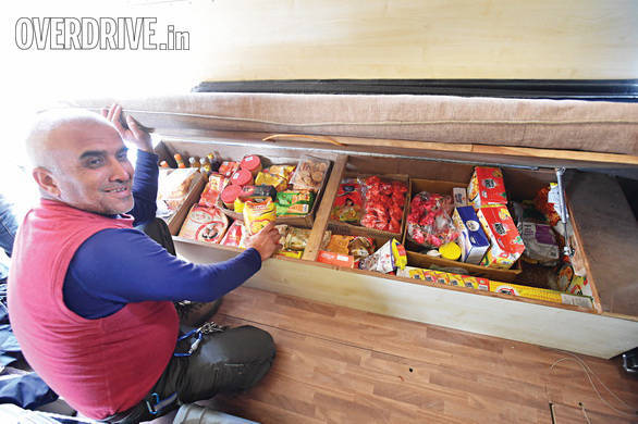 Captain Suresh with his huge stash of rations. Guests can be comfortably sustained for well nearly two months if required