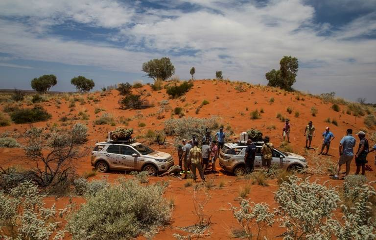 Cars often got bogged down on the sand dunes- and then it was team work