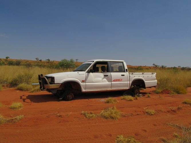 Many broken down cars are abandoned in the bush, becasue it would  be just too expensive to tow them to a proper workshop