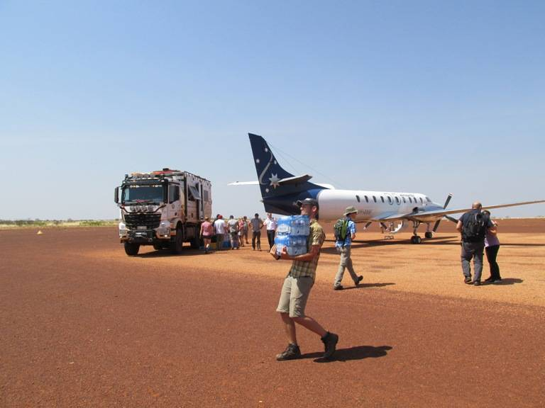 Our - Mother Ship - The 6 X 6 wheel drive truck getting re-stocked from a plane. Water also came in the plane and was the most vital thing in the bush.