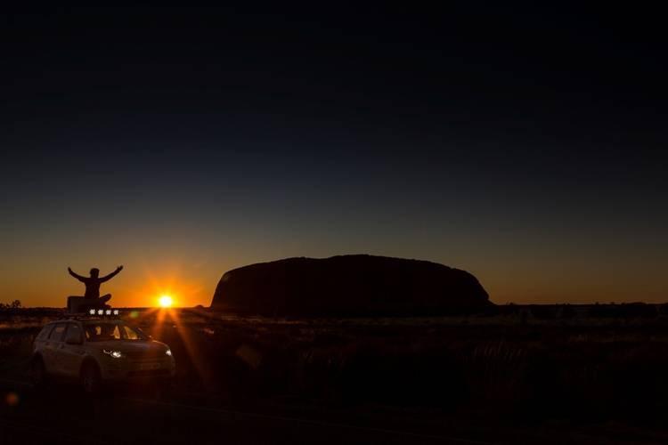 Rejoicing at the sunrise at Ayers Rock