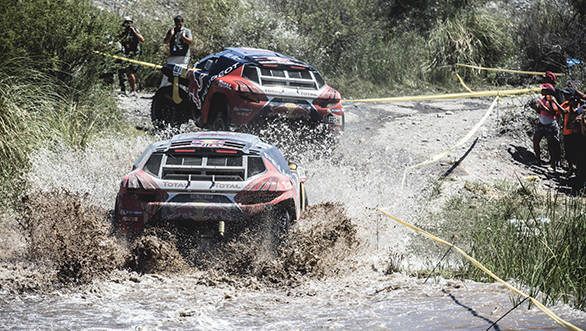 Sebastien Loeb (FRA) from Team Peugeot Total  is towed by Cyril Despres (FRA) during stage 11 of Rally Dakar 2016 from La Rioja to San Juan, Argentina on January 14, 2016. // Flavien Duhamel/Red Bull Content Pool // P-20160115-00007 // Usage for editorial use only // Please go to www.redbullcontentpool.com for further information. //