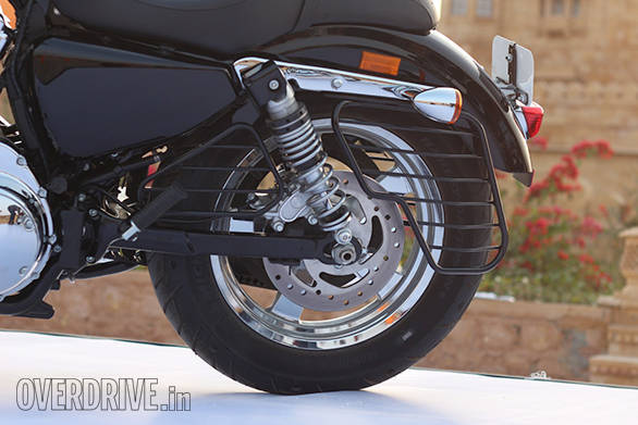 The Harley-Davidson 1200 Custom uses a box-section steel swingarm and twin rear shocks. The rear 16-inch tyre is a 150-section Michelin Scorcher