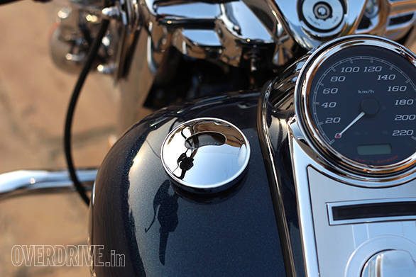 The Harley-Davidson Road King's fake gas tank cap on the left houses a small fuel gauge - width=