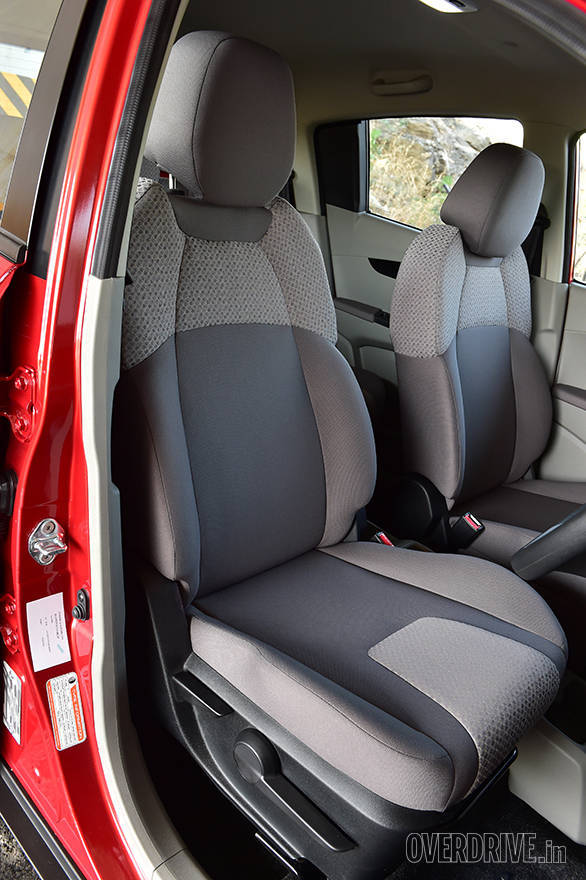 The 5-seater KUV 100 gets separate front seats with removable headrests