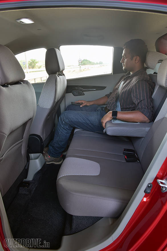 The KUV 100's rear kneeroom and headroom is a plus point. Note armrest with cupholders