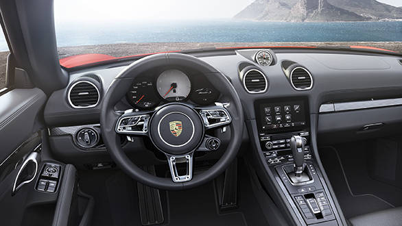 A new 918 Spyder style steering wheel in the otherwise familiar cabin