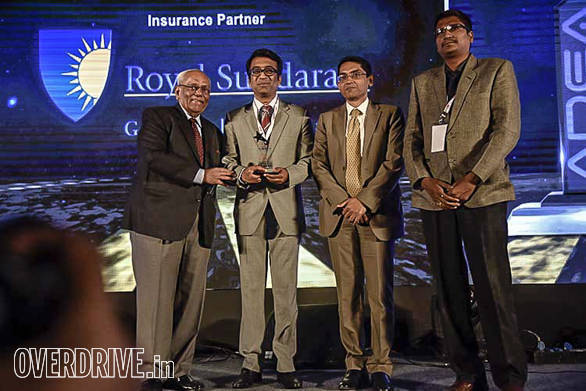 Ralas Motors getting the runner up award from Vinay Nevatia, past president FADA and Anup Kumar Saha, general manager, ICICI Bank