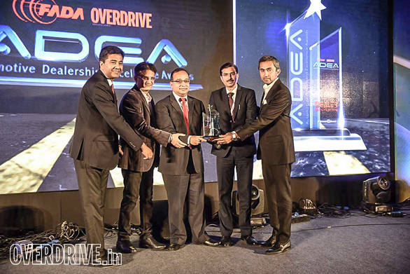 (L-R): Vishal Mathur, Vice President - Sales, Volvo Eicher CV; Sandeep Khosla, CEO, Network18 Publishing; Hemant Nagpal, Asst. General Manager, ICICI Bank Ltd presenting 4-wheeler dealer of the year award to Pasco Automobiles , Gurgaon