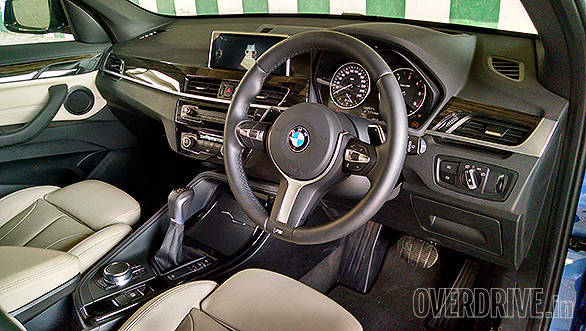 Typical BMW dashboard is simple but good looking and angled towards the driver. Note the M steering wheel