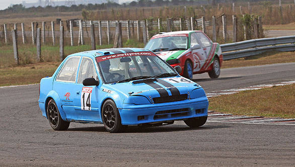 Arjun Narendran (14) leading Race 1 of the Indian Touring Car championship