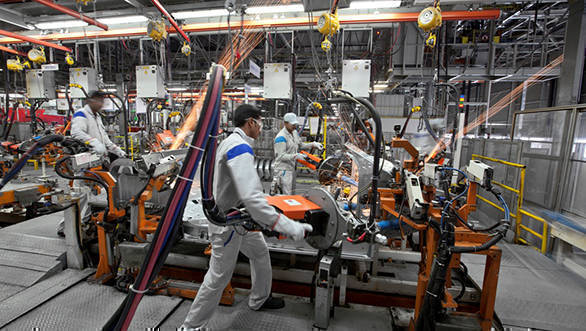 Employees at Volkswagen Pune Plant