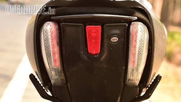 Dual LED strips double up as brake lamps and turn signals. Single grab rail can be extended by using a release mechanism under the seat. Check out how neatly the pillion foot rests fold into the body work