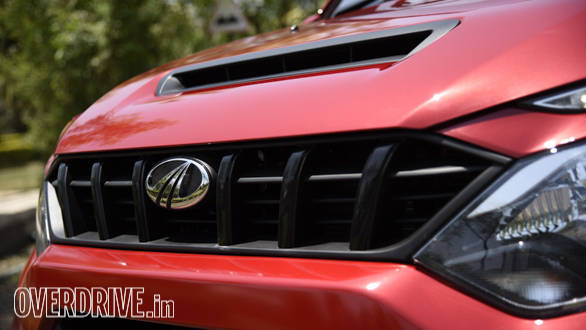 Slim grille looks good and the hood scoop is functional, feeding cool air to the top mounted radiator