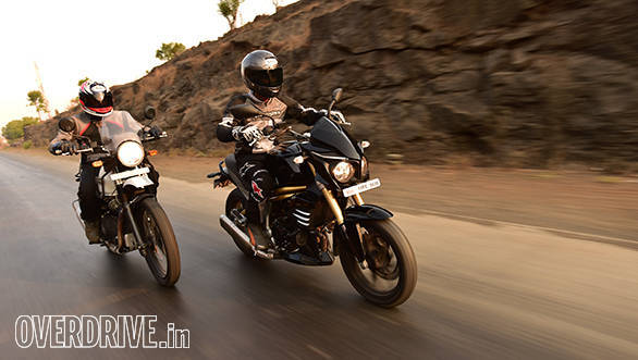 Royal Enfield Himalayan and Mahindra Mojo action shot