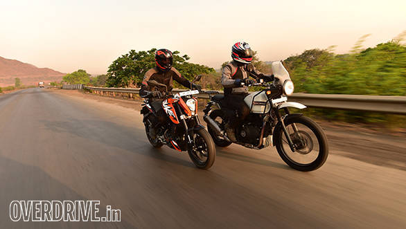 Royal Enfield Himalayan and 2016 KTM 200 Duke action shot