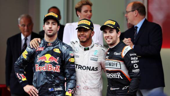 Lewis Hamilton, flanked by Daniel Ricciardo and Sergio Perez on the podium of the 2016 Monaco GP