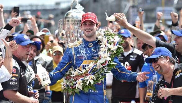 Alexander Rossi being doused with milk in the post race celebrations of the 2016 Indy500, the event's 100th running