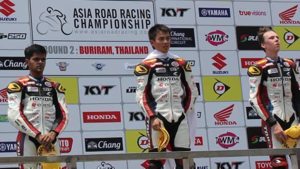 Hari Krishnan stands on the podium after his second-place finish at the Chang International Circuit