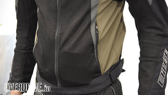 Waist adjusters fine-tune fit. The jacket sits so snug that putting anything in the pockets creates an unsightly bulge