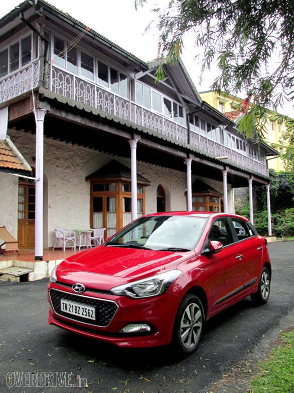 Our wheels outside our cottage at the Ootacamund Club