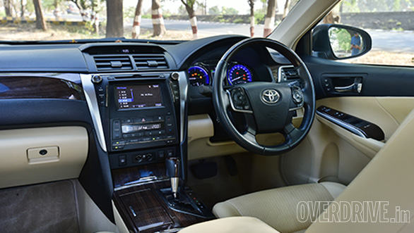 The Camry's interior feels a little plasticky, but the rear seat is more comfortable