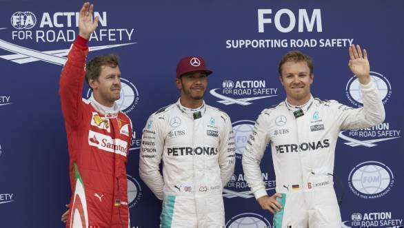 Lewis Hamilton flanked by Ferrari's Sebastian Vettel and Nico Rosberg after qualifying at the 2016 Canadian GP