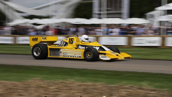 The Renault RS01 was built in 1977 and made its debut at Silverstone where it retired after 16 laps. The turbo-powered car was dismissed by rivals and then swiftly copied! Here Rene Arnoux drives it up the hill