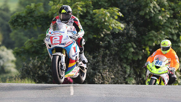 Bruce Anstey (Honda - Valvoline Racing by Padgetts Motorcycles) leads the newcomers on their speed-controlled lap on the opening session of the Monster Energy Isle of Man TT