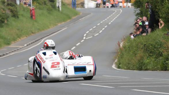 Ben Birchall and Tom Birchall (LCR Honda - IEG Racing) at Bedstead during the Sure Mobile Sidecar TT race