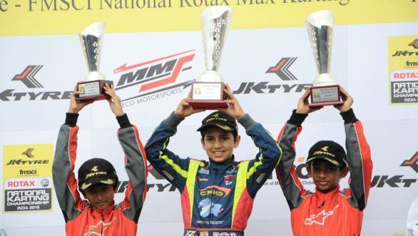 Shahan Ali Mohsin, with Ruhaan Alva and Yeasash More on the Micro Max podium