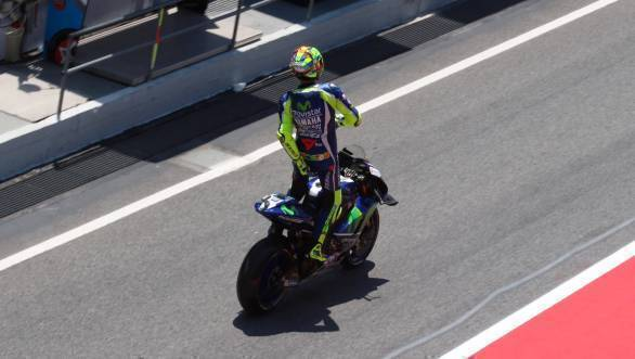 Those signature Rossi moves that are impossible to miss. Here caught in the tricky act of, er... adjusting his riding leathers