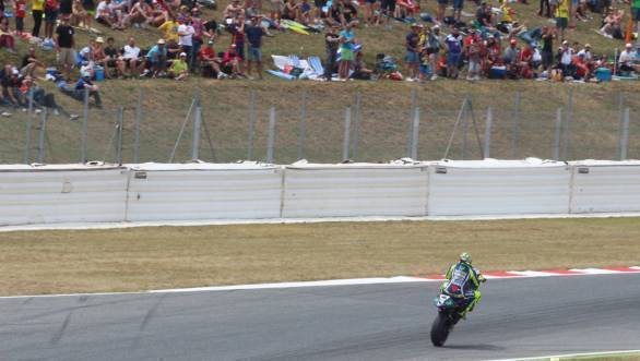 Valentino Rossi pulls a wheelie for the cheering crowds at the Catalan GP