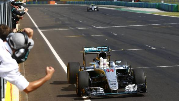 Lewis Hamilton celebrates as he crosses the line first at the 2016 Hungarian GP and moves into the lead of the driver's championship