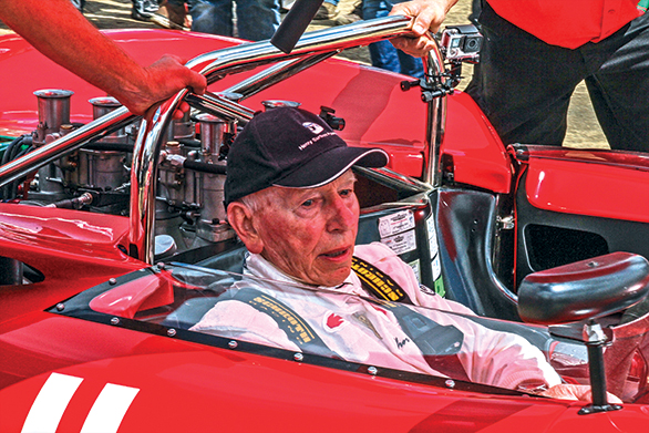 Legends like John Surtees walk through the paddock at the Goodwood FOS.