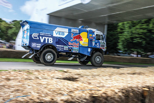 What a sight - Airat Mardeev in the Dakar Kamaz roaring past the hay bales at Goodwood