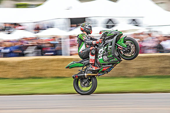 And Tom Sykes wheelied past Goodwood House, causing fans to cheer!